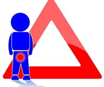 Hodenschmerzen Warnschild